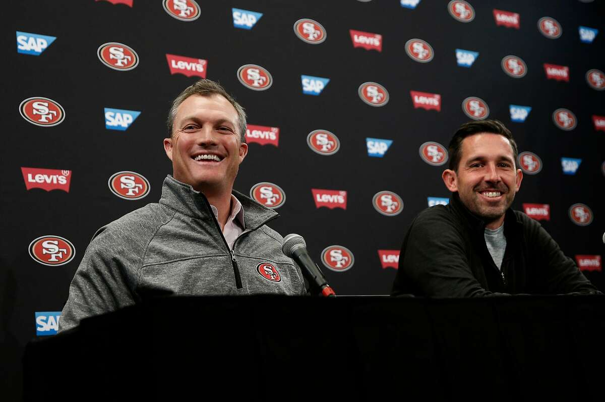 San Francisco 49ers' general manager John Lynch, (left) and head coach Kyle Shanahan share a laugh during the final press conference of the season at Levi's Stadium in Santa Clara, on Tues. January 2, 2018.