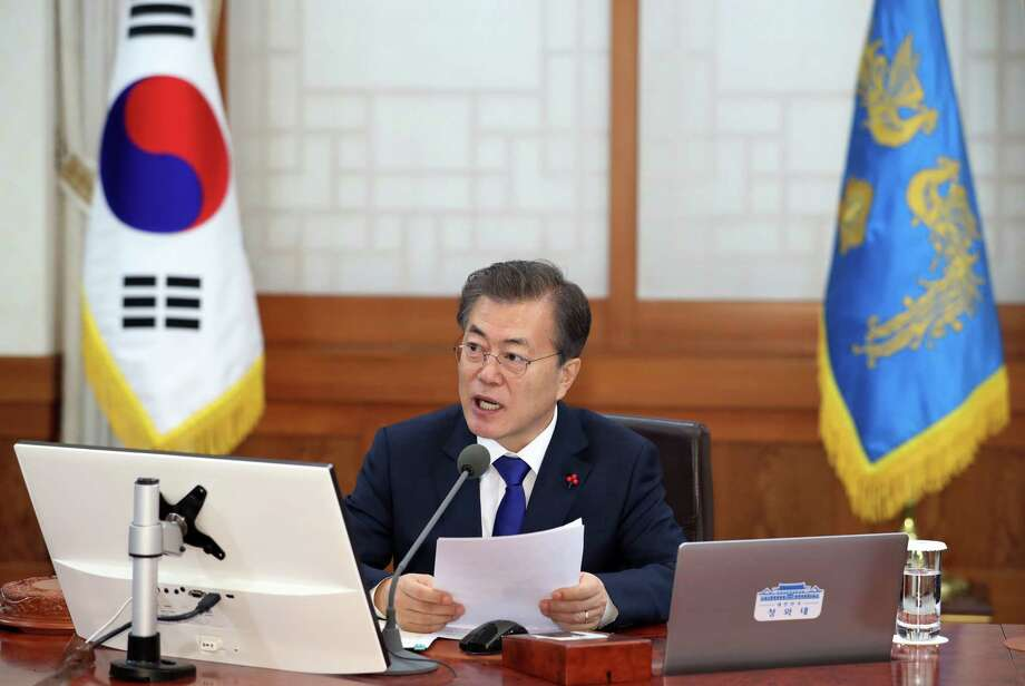 South Korean President Moon Jae-in addresses a cabinet meeting Tuesday at the presidential Blue House in Seoul, South Korea. Photo: Kim Ju-hyoung, SUB /
