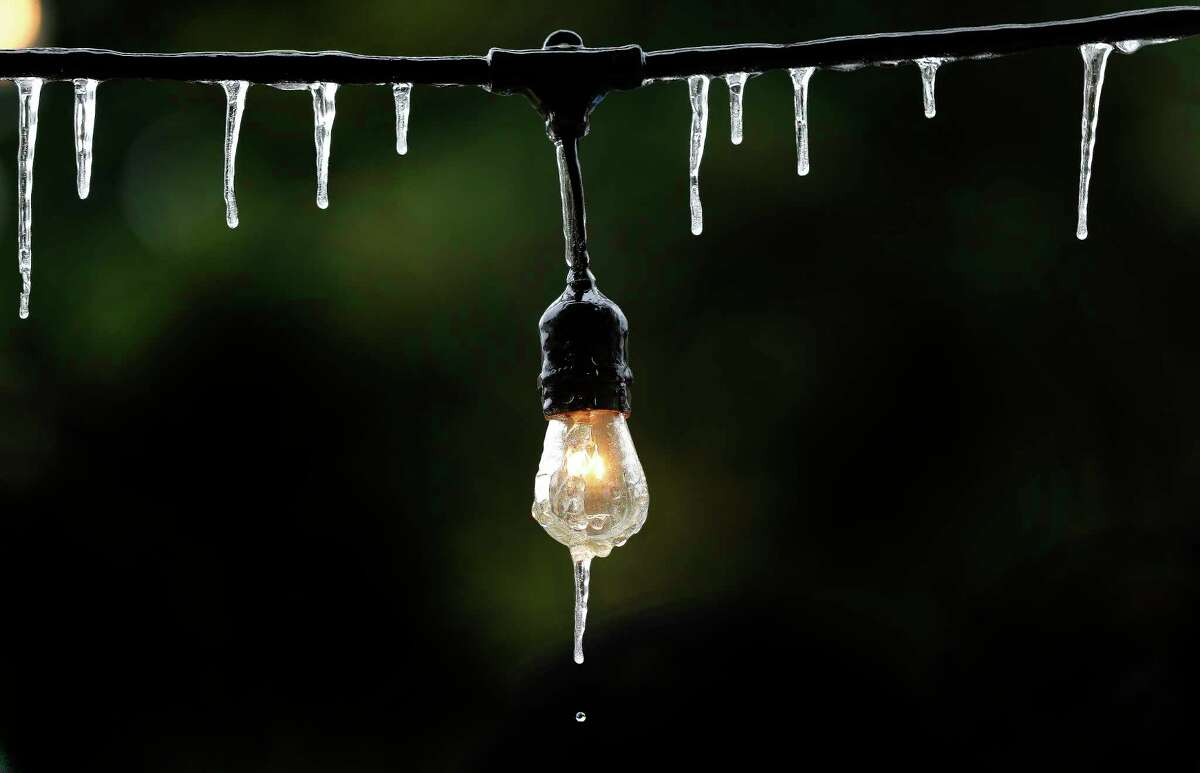 Icicles form on a outdoor string of lights as temperatures struggle to get above freezing Tuesday, Jan. 2, in Houston.  Another blast of winter that moved into Texas over the weekend is stretching power and natural gas supplies and sending prices soaring.
