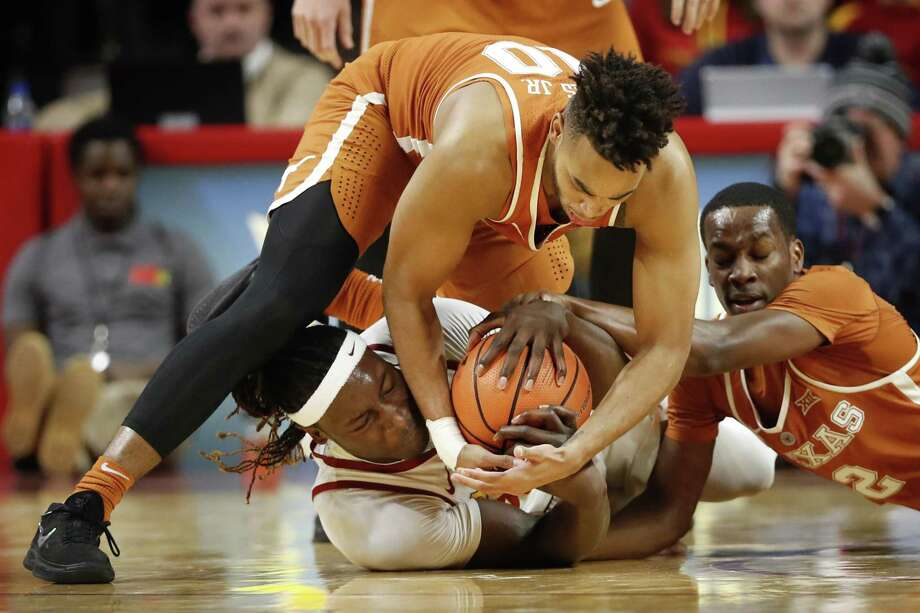 Iowa State forward Solomon Young, center, fights for a loose ball with Texas' Eric Davis Jr. (10) and Matt Coleman (2) during the first half of an NCAA college basketball game, Monday, Jan. 1, 2018, in Ames, Iowa. Photo: Charlie Neibergall /Associated Press / Copyright 2018 The Associated Press. All rights reserved.