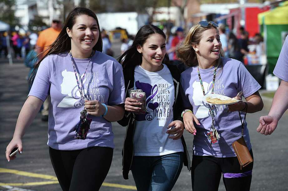 Jonathan Law juniors Lexi Fisk, 17, Basima Karzoun, 16, and Marissa Tollack, 16, walk through food truck area at the second annual Peace, Love, & Music from Maren at Jonathan Law High School, Saturday, April 30, 2016, in Milford. The event was a way to remember and celebrate the life of Maren Sanchez who was killed in the school's hallway hours before the prom April 25, 2014. (Catherine Avalone/New Haven Register) Photo: Catherine Avalone / / New Haven RegisterThe Middletown Press