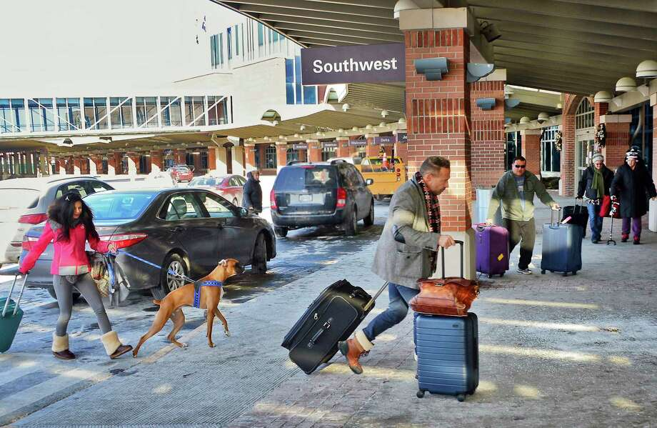 Travelers arrive at Albany International Airport Tuesday Jan. 2, 2018 in Colonie, NY.  (John Carl D'Annibale / Times Union) Photo: John Carl D'Annibale / 20042542A