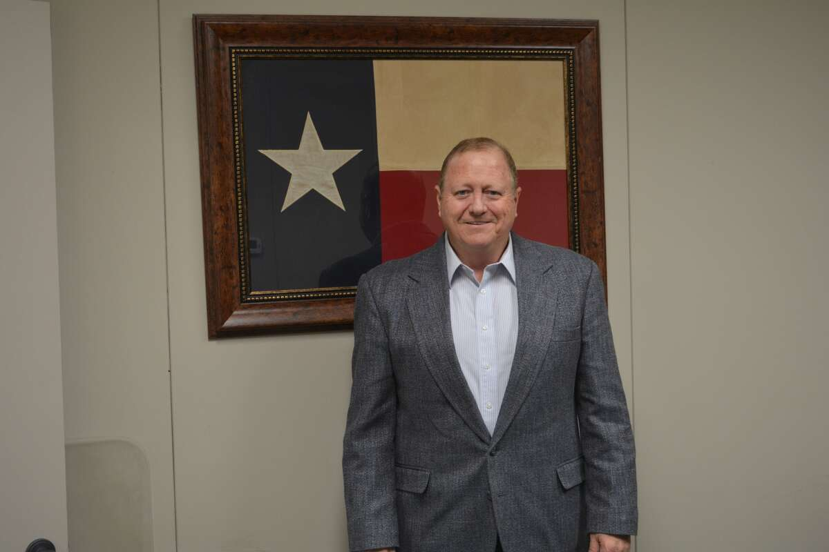 Mark Latham's office is mostly empty as he nears retirement. But a few items, including this Texas State flag, remain. Latham has served the farmers of Plainview and the surrounding area since 1984. He has worked for USDA since 1979 and is retiring after 39 years in the business.