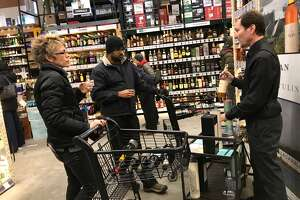 Jeremy Bloom pours and discusses the differences between three single malt Scotch whiskies at Empire Wine and Liquor in the Northway Mall in Colonie on Dec. 28.