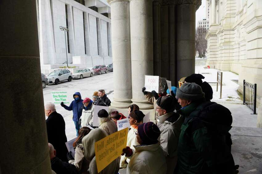 People gather for the People's State of the State event outside the Capitol on Tuesday, Jan. 2, 2018, in Albany, N.Y. The People's State of the State is held by religious, education and social welfare groups so that they can voice the legislative agenda they feel would be best for the people of New York State. Governor Andrew Cuomo will deliver his State of the State address on Wednesday. (Paul Buckowski / Times Union)