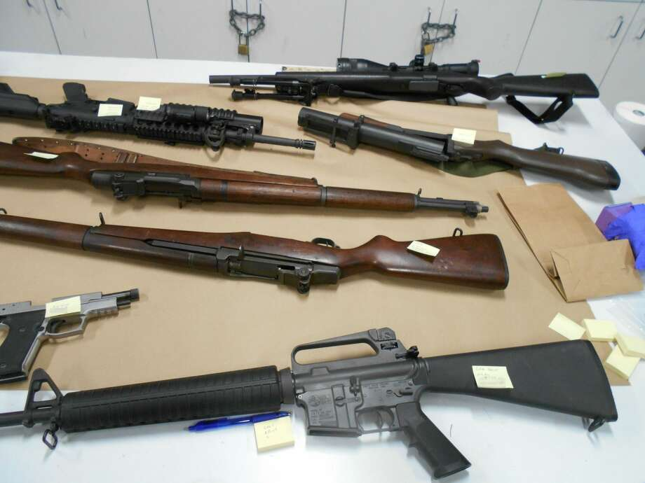 Seattle police arrested a 45-year-old man Sunday night and seized at  least 35 firearms from his home after a domestic violence incident drew  and officer response.He was not prohibited from owning them and they were all legally  owned as far as police know as of Tuesday, but domestic violence victims  can request their removal. A court can order them removed, as well. Photo: Courtesy Seattle Police Department