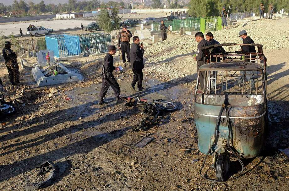 Security forces inspect the site of a bombing in Jalalabad province, east of Kabul, Afghanistan, on Sunday. Officials say the attack targeted the funeral of a local official, killing at least 15 people. Photo: Mohammad Anwar Danishyar, STR / Copyright 2017 The Associated Press. All rights reserved.
