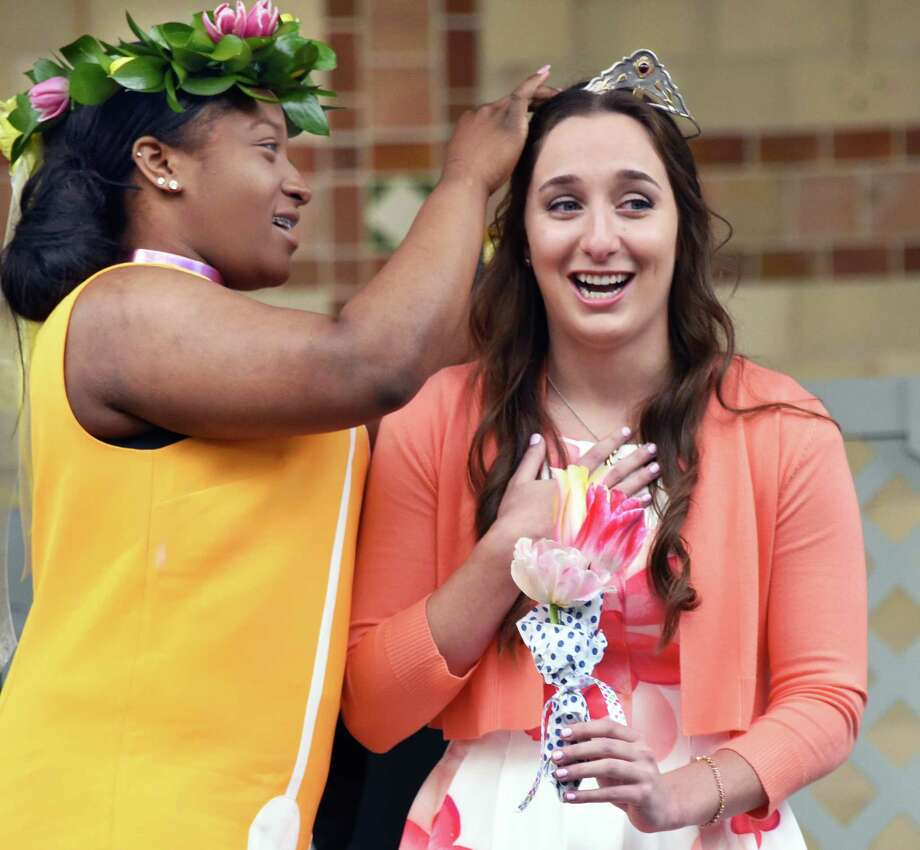 2017 Tulip Queen Ashley Loggins, right, is crowned by last year's queen Adaviah Ward during the 69th Annual Albany Tulip Festival Saturday May 13, 2017 in Albany, NY.  (John Carl D'Annibale / Times Union) Photo: John Carl D'Annibale / 20040468A