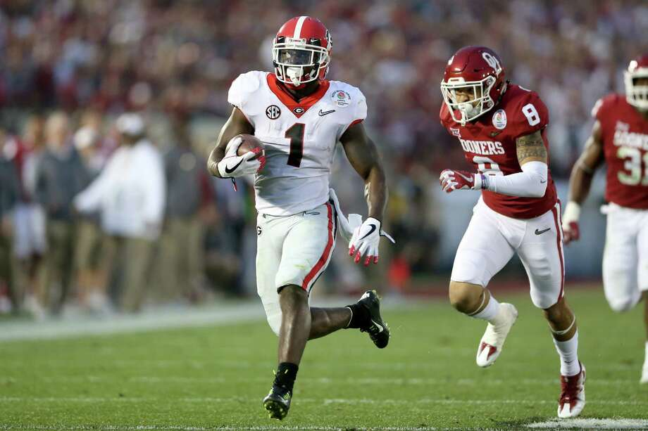 PASADENA, CA - JANUARY 01:  Running back Sony Michel #1 of the Georgia Bulldogs scores on a 38-yard touchdown in the third quarter against the the Oklahoma Sooners in the 2018 College Football Playoff Semifinal at the Rose Bowl Game presented by Northwestern Mutual at the Rose Bowl on January 1, 2018 in Pasadena, California.  (Photo by Matthew Stockman/Getty Images) Photo: Matthew Stockman / 2018 Getty Images