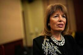 """WASHINGTON, DC - DECEMBER 12:  U.S. Rep. Jackie Speier (D-CA) speaks to a member of the media after a news conference  December 12, 2017 on Capitol Hill in Washington, DC. House Democrats call on """"investigating President Trump for sexual misconduct.""""  (Photo by Alex Wong/Getty Images)"""