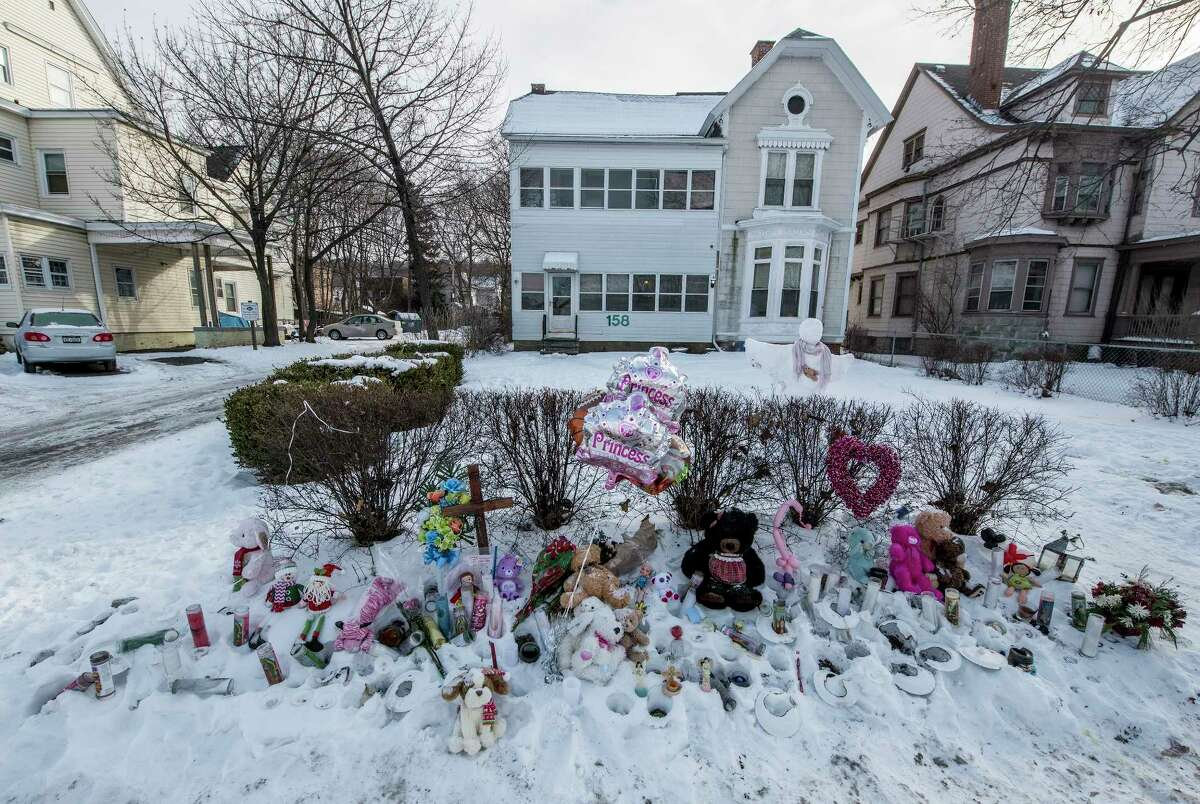 The makeshift memorial for the victims of the quadruple murder at 158 2nd Avenue continues to crow Tuesday morning Jan 2, 2018 in Troy, N.Y. (Skip Dickstein/ Times Union)