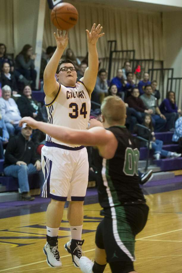 Calvary Baptist senior Daniel Singletary takes a shot during the Kings' game against Houghton Lake on Tuesday, Jan. 2, 2018 at Calvary Baptist Academy. (Katy Kildee/kkildee@mdn.net) Photo: (Katy Kildee/kkildee@mdn.net)