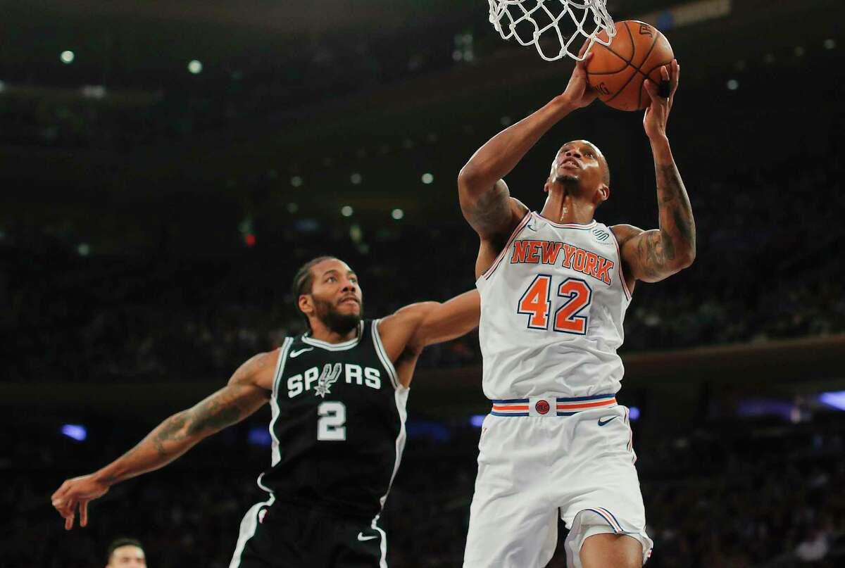 New York Knicks forward Lance Thomas (42) puts up a shot against San Antonio Spurs forward Kawhi Leonard (2) during the second quarter of an NBA basketball game, Tuesday, Jan. 2, 2018, in New York. (AP Photo/Julie Jacobson)