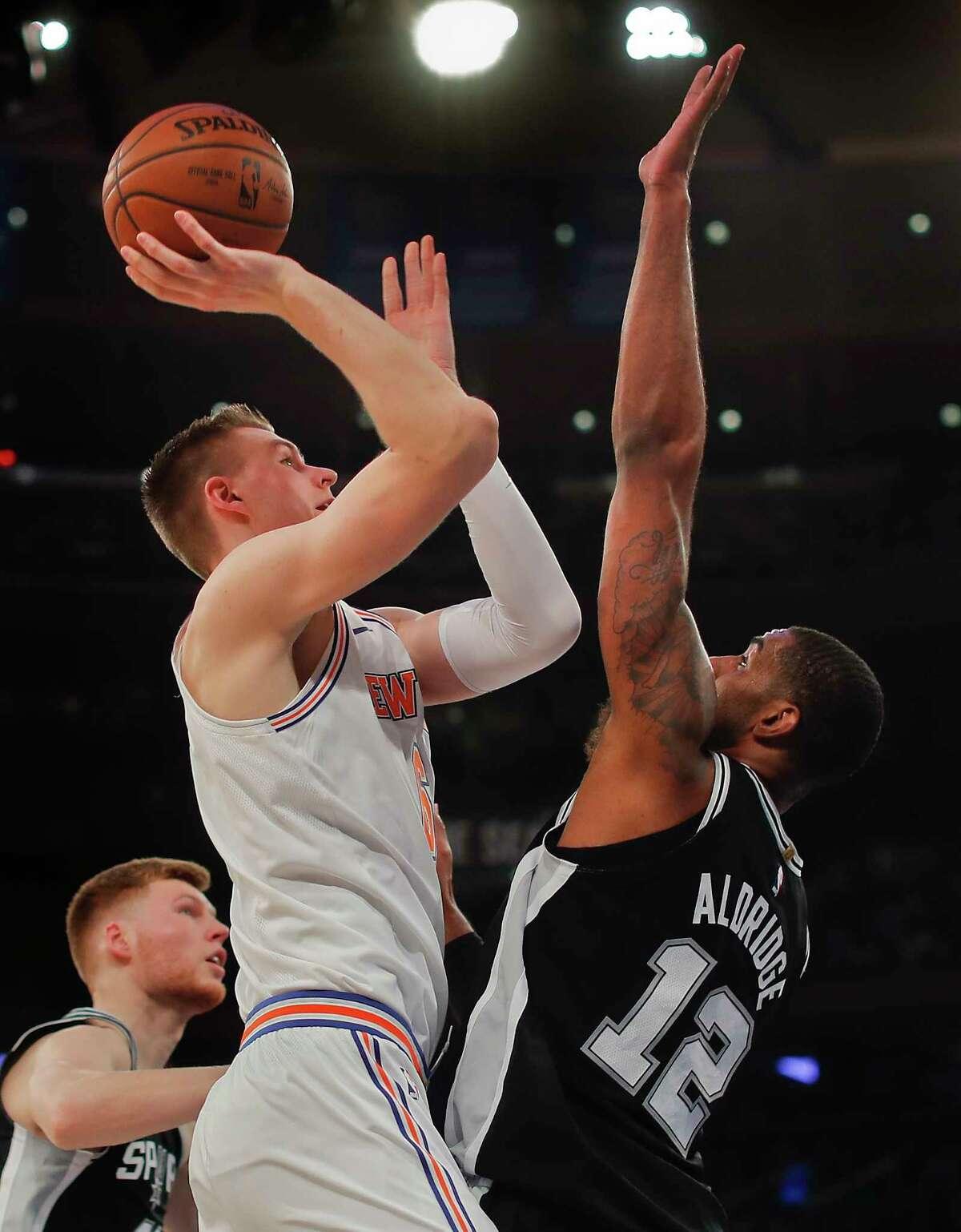 New York Knicks forward Kristaps Porzingis (6) puts up a shot against San Antonio Spurs forward LaMarcus Aldridge (12) during the first quarter of an NBA basketball game, Tuesday, Jan. 2, 2018, in New York. (AP Photo/Julie Jacobson)