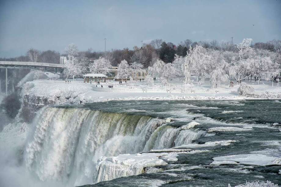 A frozen Niagara Falls is seen Tuesday in views from Stedman's Bluff on Goat Island of the American Falls and Prospect Point beyond.  Photo: James Neiss, MBR / JamesNeiss