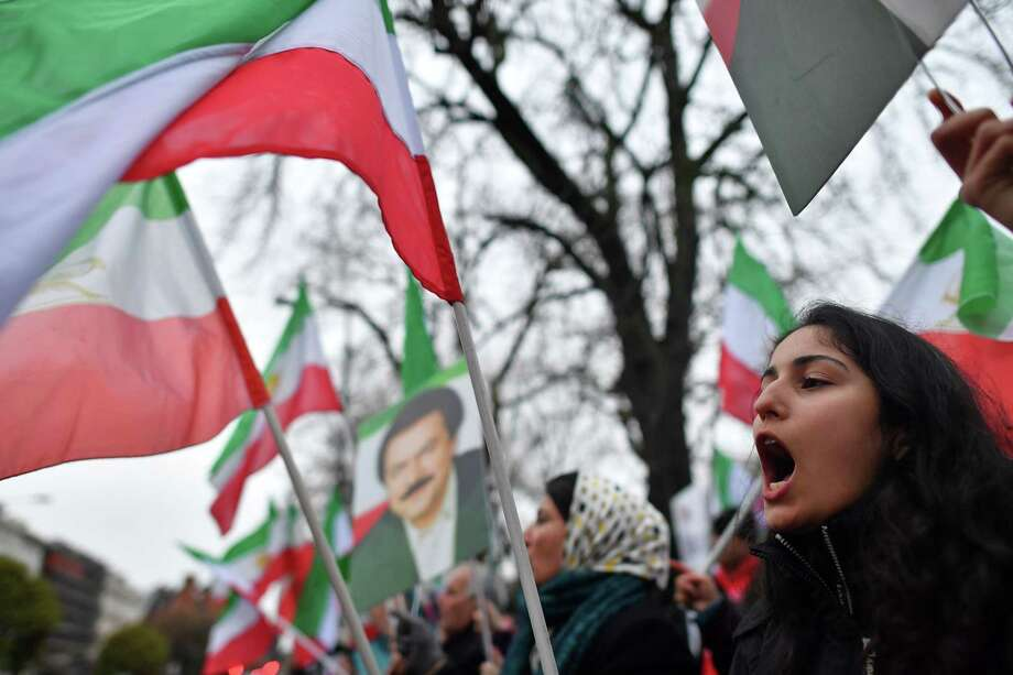 Protesters gather outside the Iranian Embassy in London on Tuesday in  support of national demonstrations in Iran against the entire political establishment. Photo: BEN STANSALL, Contributor / AFP or licensors