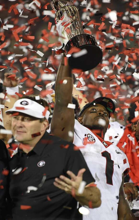 Georgia running back Sony Michel (1) holds the trophy after his team beat Oklahoma 54-48 in overtime in the Rose Bowl NCAA college football game Monday, Jan. 1, 2018, in Pasadena, Calif. (AP Photo/Mark J. Terrill) Photo: Mark J. Terrill, Associated Press