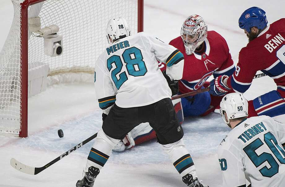 The Sharks' Timo Meier (28) scores in the second period, the first of his two goals against the Canadiens' Carey Price, as Jordie Benn (8) and the Sharks' Chris Tierney look for the rebound. Photo: Graham Hughes, Associated Press