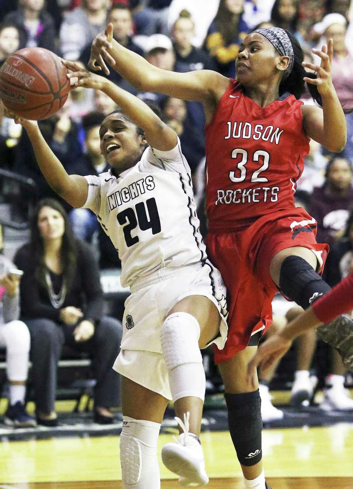 Knight guard Desiree Caldwell yanks down a defensive rebound away from Desiree Lewis as Steele hosts Judson in girls basketball on January 2, 2018