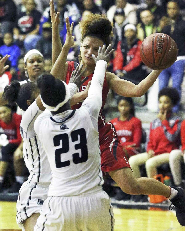 Rocket guard Corina Carter tries a tough pass through the lane as Steele hosts Judson in girls basketball on January 2, 2018