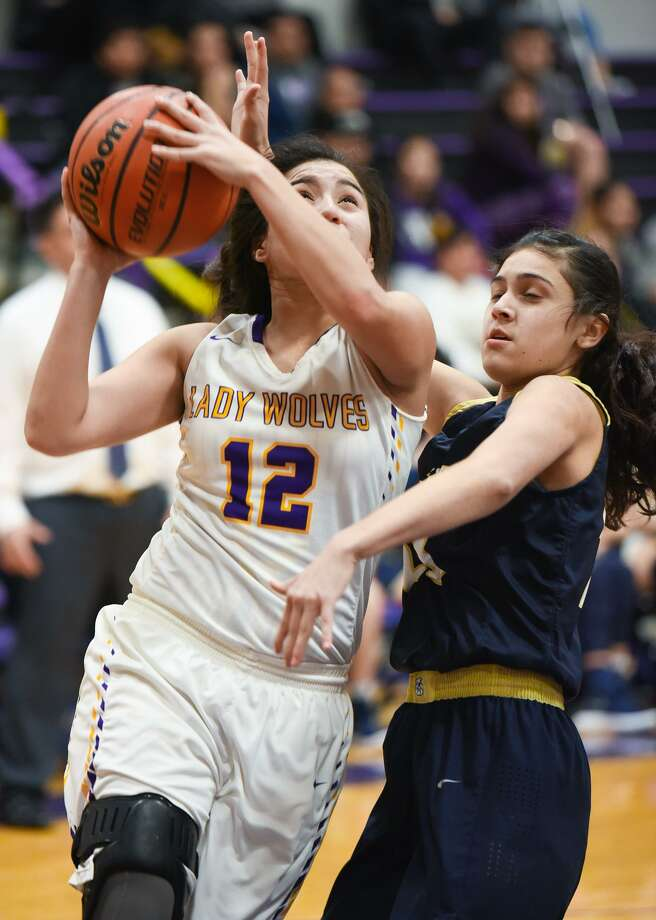 LBJ's Deynira Martinez matched fellow senior Leslie Cortes with a team-high 12 points Tuesday in a 77-37 loss to Alexander. Photo: Danny Zaragoza /Laredo Morning Times