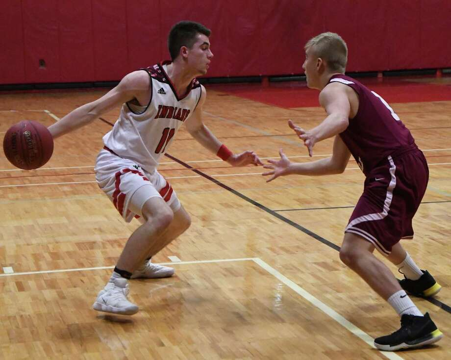 Glens Falls point guard Joseph Girard III faces off with Scotia's Marcus Frechette during a regular season game on Tuesday, Dec. 19, 2017, in Glens Falls, N.Y. Girard surpassed Jimmer Fredette in points for the Glens Falls's school record, placing third overall in Section II. (Jenn March/Special to the Times Union) Photo: Jenn March / © Jenn March Photography © Albany Times Union