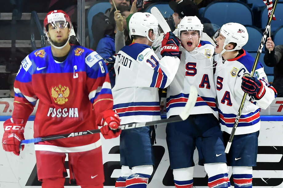 United States forward Kieffer Bellows, center, celebrates his goal with teammates Casey Mittelstadt, second left, and Joey Anderson as Russia defenseman Yegor Zaitsev (6) looks on during the first period of a quarterfinal hockey game in the IIHF World Junior Championships in Buffalo, N.Y., Tuesday, Jan. 2, 2018. (Nathan Denette/The Canadian Press via AP) Photo: Nathan Denette / CP