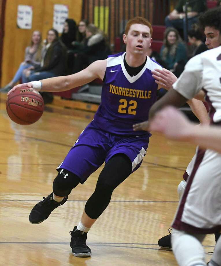 Voorheesville's Joe Saia drives to the basket to score two points during a basketball game against Bishop Gibbons on Tuesday, Jan. 2, 2018 in Schenectady, N.Y.  (Lori Van Buren / Times Union) Photo: Lori Van Buren / 20042537A