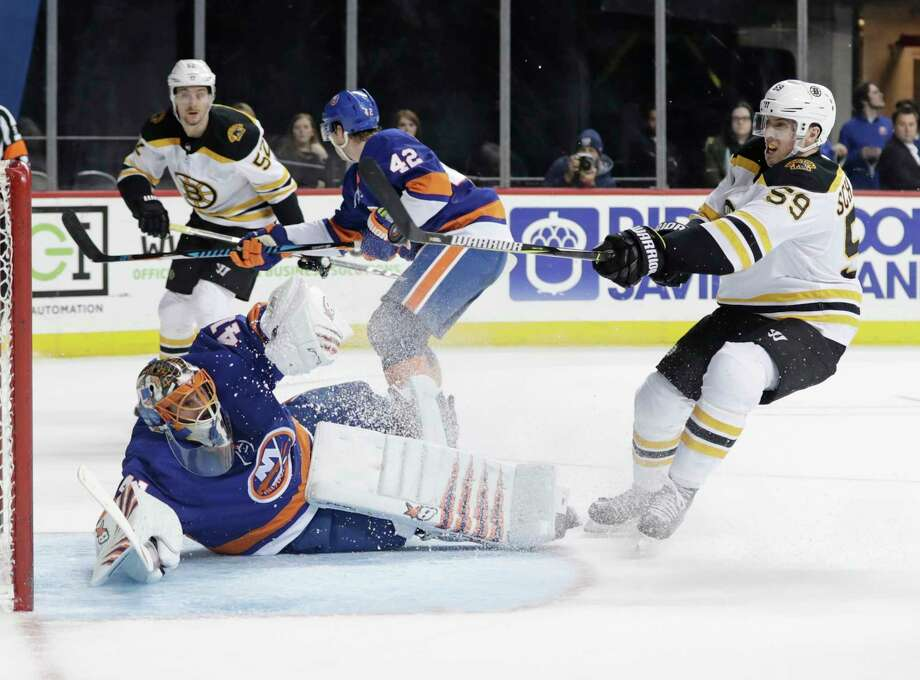 Boston Bruins' Tim Schaller (59) shoots the puck past New York Islanders goaltender Jaroslav Halak during the third period of an NHL hockey game Tuesday, Jan. 2, 2018, in New York. The Bruins won 5-1. (AP Photo/Frank Franklin II) Photo: Frank Franklin II / Copyright 2018 The Associated Press. All rights reserved.