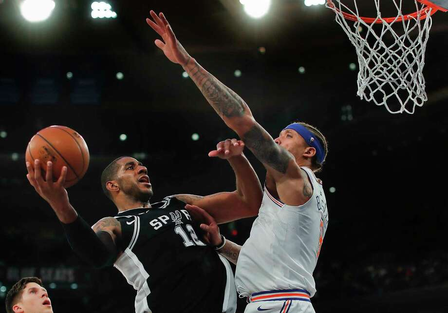 San Antonio Spurs forward LaMarcus Aldridge (12) puts up a shot against New York Knicks forward Michael Beasley (8) during the third quarter of an NBA basketball game, Tuesday, Jan. 2, 2018, in New York. The Spurs won 100-91. (AP Photo/Julie Jacobson) Photo: Julie Jacobson / Copyright 2018 The Associated Press. All rights reserved.