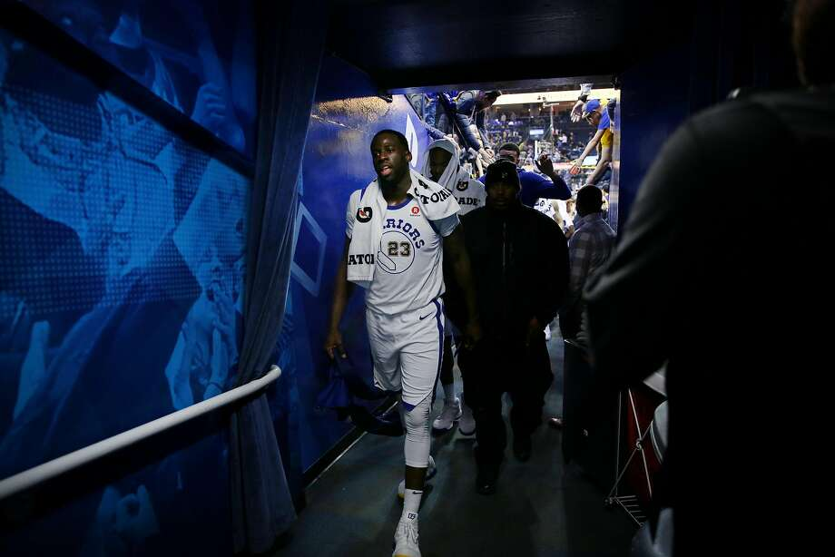 Golden State Warriors forward Draymond Green (23) exits following the end of an NBA basketball game between the Golden State Warriors and Charlotte Hornets at Oracle Arena, Friday, Dec. 29, 2017 in Oakland, Calif. The Hornets won 111-100. Photo: Santiago Mejia, The Chronicle