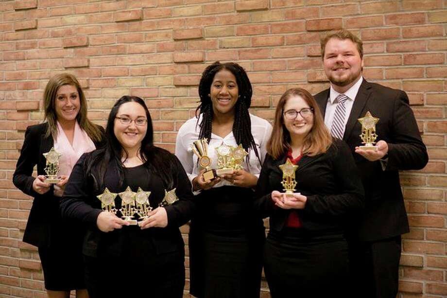 Saginaw Valley State University forensics students, from left, Allison Milke, Jill Castle, Jayla Gaskins, Tiler Jewell and Jrew Bickel are pictured at the fall Michigan Intercollegiate Speech League tournament at Oakland University. (Photo provided)