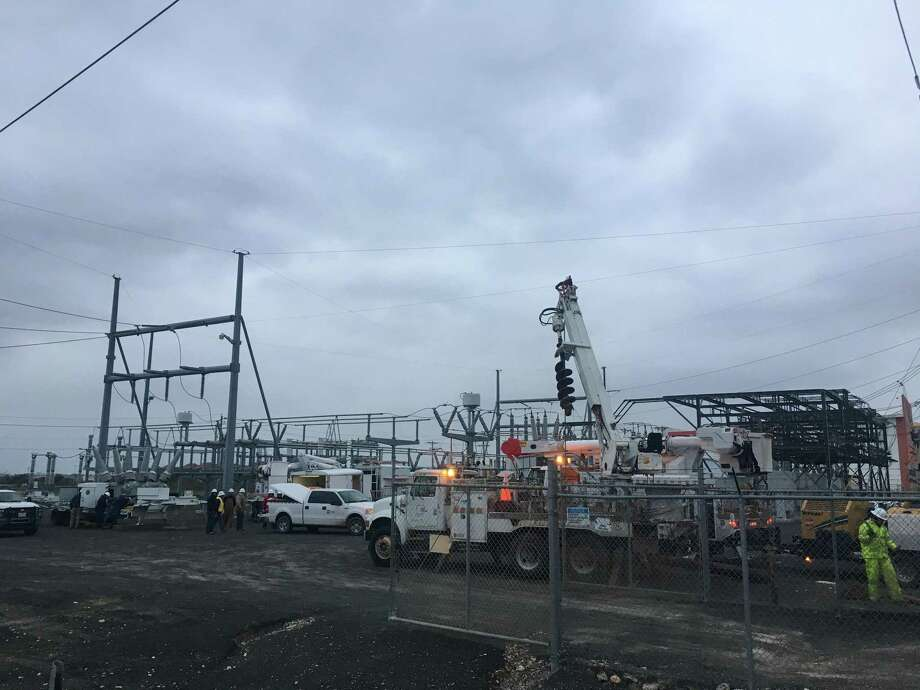 Workers are on site at AEP's substation on Del Mar Boulevard, Tuesday evening. AEP is relocating a portable substation here to provide a relief point, the company's manager of external affairs for Laredo said Tuesday. Photo: Julia Wallace /Laredo Morning Times