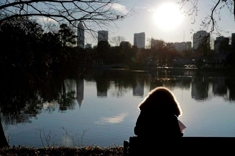 A person sits bundled in a winter jacket while looking out over the midtown skyline in Atlanta, Tuesday, Jan. 2, 2018. A prolonged stretch of brutal cold is taking a toll in the South, and temperatures in Atlanta are expected to dive well below freezing every night this week through Saturday night, the National Weather Service said Tuesday. Photo: David Goldman, AP / Copyright 2018 The Associated Press. All rights reserved.