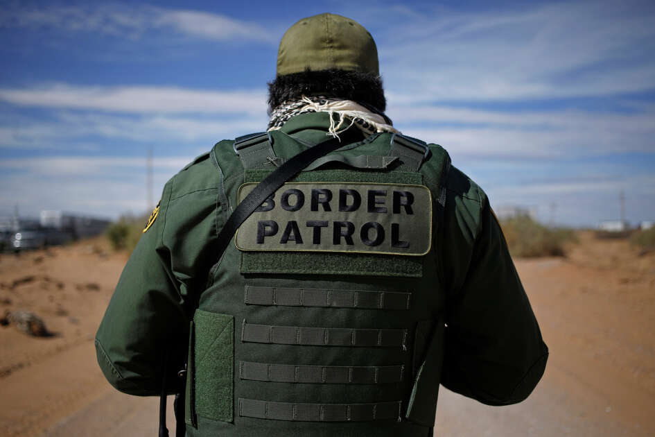 A U.S. Border Patrol agent stands for a photograph while keeping watch along the U.S. and Mexico border in Santa Teresa, New Mexico, on Feb. 17, 2017.