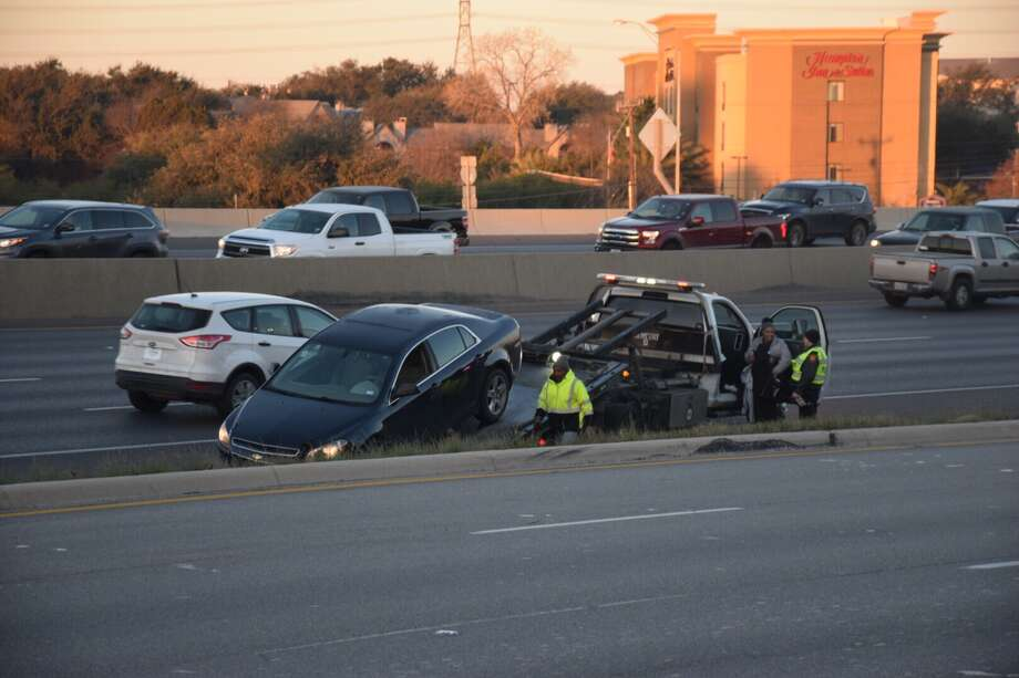 A Northwest Side furniture store left their sprinklers on overnight, causing iced over roads and at least three crashes. Photo: Caleb Downs / San Antonio Express-News