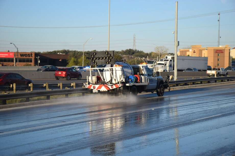 TxDOT treat the icy roadway with a brine solution near Huebner Road and Interstate 10 Wednesday morning, Jan. 3, 2018. Crews will be out treating highways before another anticipated freeze in 2019. Photo: Caleb Downs/San Antonio Express-News