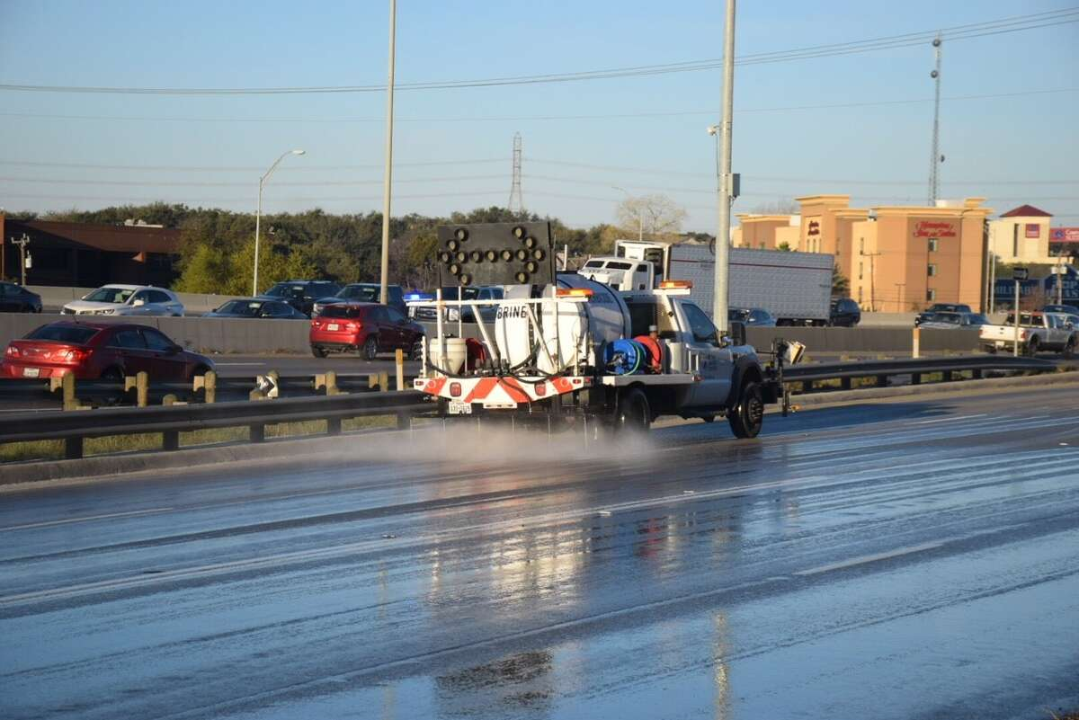 A TxDOT crew treats an icy roadway with a brine solution in 2018.
