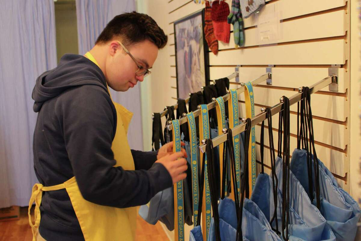 Fairfield resident Chris Lopes has been working at Woofgang & Co. since the nonprofit opened its retail location in December.
