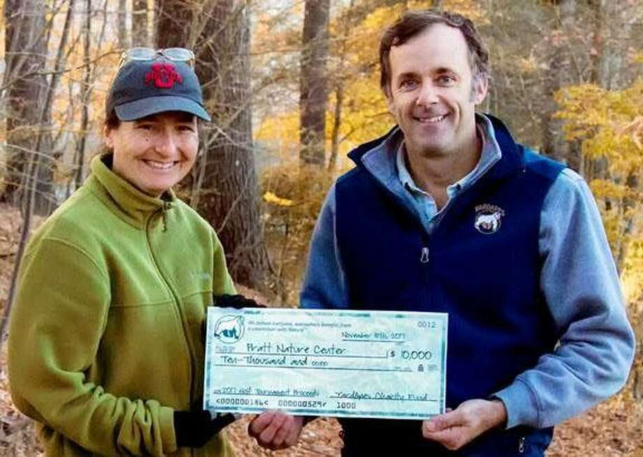 YardApes in New Milford recently presented the Pratt Nature Center in town a check for $10,000. Funds were raised at YardApes' 12th annual Quad-Am Golf Classic held at Bulls Bridge Golf Club in South Kent. Above, Shayne Newman, founder and host of the classic, right, presents the check to Diane Swanson, director of the nature center. Photo: Courtesy Of YardApes / The News-Times Contributed