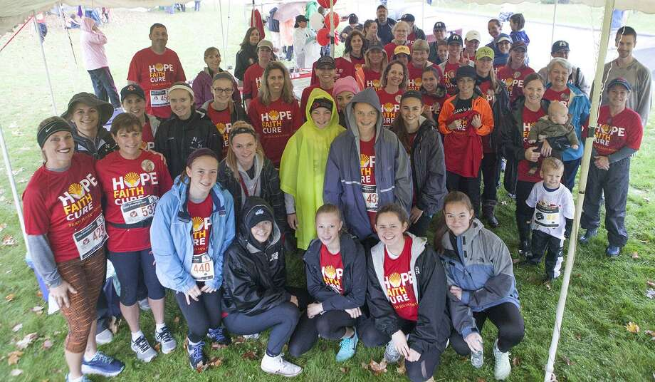 The weather may not have cooperated, but that didn't deter a crowd of participants from supporting Team Julia's Wings at the recent Kent Pumpkin Run. The team comprised approximately half of the race participants, including the volunteers the day of the race, as well as the runners, walkers and supporters. All funds raised from this years run will go directly toward Julia's Wings Foundations Family Assistance 2018 budget. The non-profit foundation honors the late Julia Malsin of Sherman by providing assistance to families of children with the life threatening hematological diseases; aplastic anemia, MDS and PNH, raising awareness of these diseases, and funding medical research. Photo: Courtesy Of Julias Wings Foundation / The News-Times Contributed