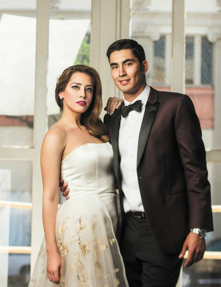 The Bridal IssueModeled by Karla Benavides & Patricio CanavatiPhotographed by Rolando SanchezStyled by Phebe Robinson & Ariel GomezBridal Gowns from La SposaTuxedos from Los Dos Laredo's Tailor ShopHair by Marty Rodriguez of Marty's Hair Art Beauty SalonMakeup by Mika Ziesman of Hollywood Beauty LabSet & Floral design by Phebe Robinson of Making Me EventsShot on location at the Laredo Center for the Arts Photo: Rolando Sanchez/Dvino Magazine