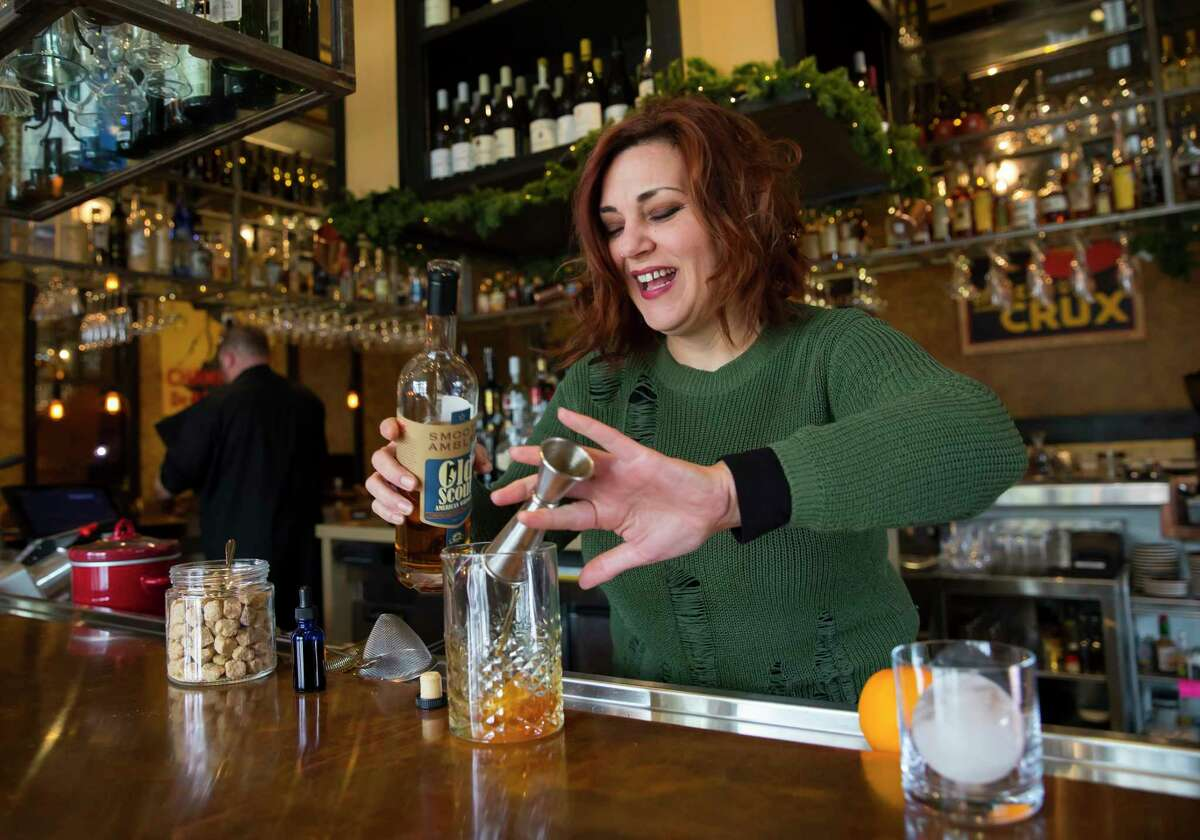 Brasserie Du Parc bartender Kimberly Paul prepares an Old-Fashioned on Monday, Dec. 18, 2017, at the downtown location in Houston. (Annie Mulligan / Freelance)