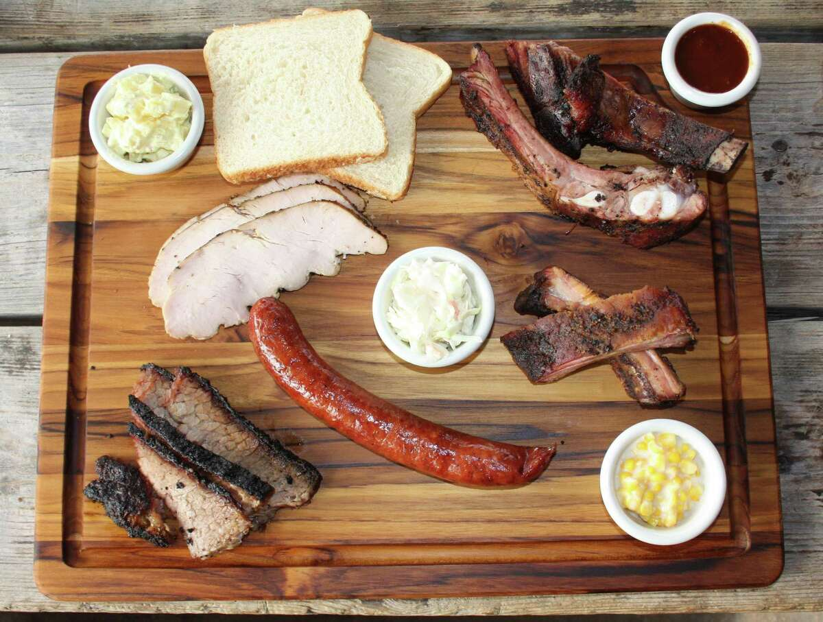 Clockwise from top: pork spare ribs, baby back ribs, sausage links, brisket and turkey at Rudy's Country Store and Bar-B-Q.