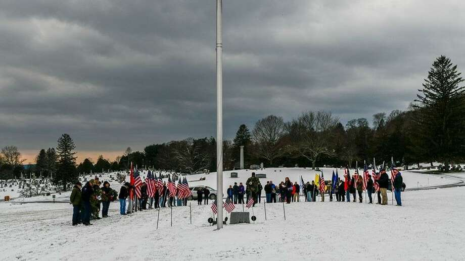 Residents of the Greater New Milford gather to place wreaths on veterans' graves at Center Cemetery in New Milford. Photo: Courtesy Of Jean Mariano / The News-Times Contributed