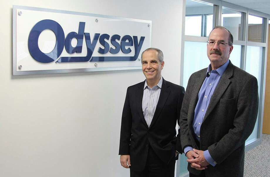 Odyssey COO/CFO Cosmo Alberico and CEO Robert Shellman stand in their company's new office space at the Matrix Corporate Center in Danbury, Conn., on Thursday, Feb. 16, 2017. Photo: Chris Bosak / Hearst Connecticut Media / The News-Times