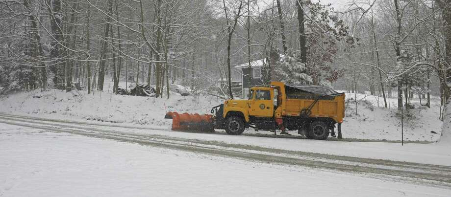 A plow clears a road in Bethel, Conn, on Saturday. December, 9, 2017. Photo: H John Voorhees III / Hearst Connecticut Media / The News-Times