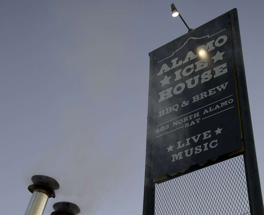 The outside sign at Alamo Ice House at 802 N. Alamo St. Photo: Xelina Flores For The Express-News