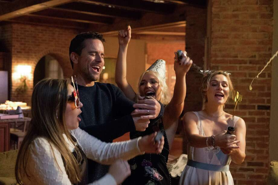 """One of the calmer moments on what's shaping up to be an emotional roller coaster ride of a final season of """"Nashville,"""" which was created by S.A. native Callie Khouri. Here, widower Deacon (Charles Esten), his daughters Maddie and Daphne (real-life sisters Lennon and Maisy Stella) and his niece Scarlett (Clare Bowen) share an intimate family New Year's celebration. Photo: Jake Giles Netter /CMT"""