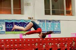 With her teammates cheering her on, Darien YMCA Level 6 gymnast Anna Altier (New Canaan) flipped to a huge 9.4 score to win the floor title at the New England Invitational.